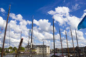 Many ships parked near the shore in Amsterdam — Stock Photo