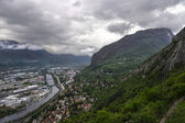 Panorama of Grenoble with Alps and deep clouds in background — Stock Photo