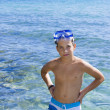 Cute eleven years old boy staying in the sea — Stock Photo