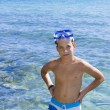 Cute eleven years old boy staying in the sea — Stock Photo #29703715