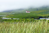 Fog over the village, Iceland, summer — Stock Photo