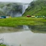 Tent camp near Skogarfoss waterfall in Iceland, summer — Stock Photo #30233851