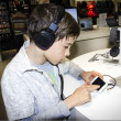 Portrait of sweet young boy listening to music on headphones — 图库照片 #30416345