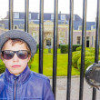 Handsome boy in sunglasses near the fence of old house, Haarlem, — Stock Photo