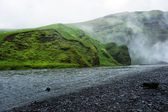 Skoga river near Skogafoss waterfall in Iceland, rainy summer — Stock Photo