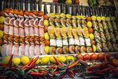 Shashliks with salmon, beef fillet, cheese, lemon, onion, papri — Stock Photo