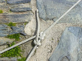 Rope And Knot Against Stone Background — Stock Photo