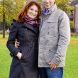Outdoor happy couple in love posing against autumn Amsterdam bac — Stock Photo