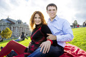 Outdoor happy couple in love, Museum Plein, autumn Amsterdam bac — Stock Photo