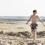 Portrait of teenage is walking on sand near sea — Stock Photo #48541543