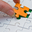 Hands placing piece of a Puzzle — Stock Photo