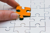Hands placing piece of a Puzzle — Foto Stock