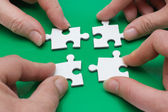 Four with puzzle — Stock Photo