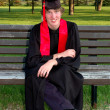 Royalty-Free Stock Photo: Happy Graduate in Cap and Gown