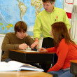 Teacher and Teen Students in Classroom — Stock Photo