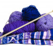 Knitting yarn needles and sweater — Stock Photo
