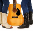 Guitar Cowgirls in Cowboy Boots - Stock Photo