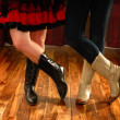 Line Dancing Female Legs in Cowboy Boots - Stock Photo