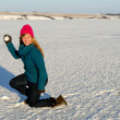 Playful Winter Woman with Snowball - Stock Photo