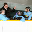 Hockey Coach on Bench With Players - Foto Stock
