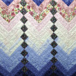 Stock Photo: Home Made Country Quilt in Blue and Pink Patchwork