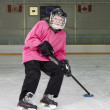 Stock Photo: Ringette Skater in Action at Rink