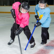 Stock Photo: Ringette Players in Action at Hockey Rink