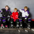 Stock Photo: Youth Hockey Players in Dressing Room