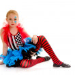 Stock Photo: Seated Child Circus Jester in Colorful Costumer