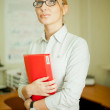 A woman with a folder in the office — Stock Photo