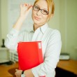 A woman with a folder — Stock Photo #13541633