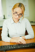 Businesswoman at the keyboard — Stock Photo