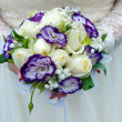 Wedding bouquet of blue and white flowers — Stock Photo