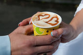 Cappuccino with heart shape. bride and groom drink a cup of Capp — Stock Photo