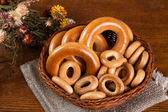 Large and small bagels in basket — Stock Photo