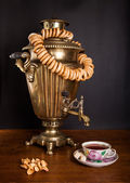 Samovar, bagels and a cup of tea — Stock Photo