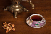 Samovar and a cup with tea — Stock Photo
