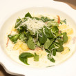 Stock Photo: Gnocchi with cream sauce in white dish