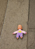 Doll on the ground — Stock Photo