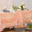 Stock Photo: Wedding table with peach arrangements