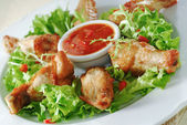 Chicken wings with spicy sauce — Stock Photo