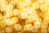 Golden beautiful spots bokeh as background — Stock Photo