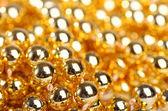 Many little golden balls — Stockfoto