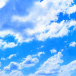 Stock Photo: Bright white clouds in blue sky