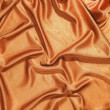 Golden silky fabric — Stock Photo #22572817