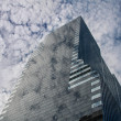 Clouds reflection in glass skyscraper — Stock Photo #23076628