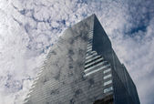 Clouds reflection in a glass skyscraper — Stock Photo