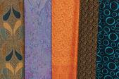 Varicolored fabric at a market — Stock Photo