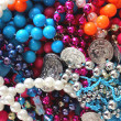 Mardi Gras Beads and Bangles - Stock Photo
