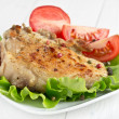 Roasted pork fillet on a piece of lettuce — Stock Photo